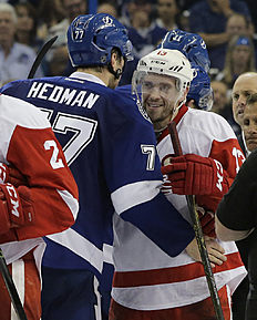Detroit Red Wings center Pavel Datsyuk, of Russia, right, hugs Tampa Bay Lightning defenseman Victor Hedman (77), of Sweden, after the Lightning defeated the Red Wings 1-0 during Game 5 in a first-round NHL hockey Stanley Cup playoff series Thursday, April 21, 2016, in Tampa, Fla. (AP Photo/Chris O'Meara)