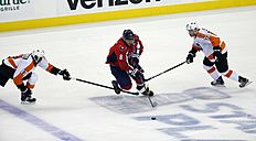 Washington Capitals left wing Alex Ovechkin (8), from Russia, skates with the puck between Philadelphia Flyers right wing Wayne Simmonds (17) and defenseman Mark Streit (32), from Switzerland, during the third period of Game 5 of an NHL hockey Stanley Cup playoffs first-round series Friday, April 22, 2016, in Washington. The Flyers won 2-0. (AP Photo/Alex Brandon)
