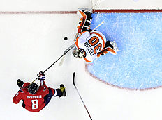 Washington Capitals left wing Alex Ovechkin (8), from Russia, has his shot blocked by Philadelphia Flyers goalie Michal Neuvirth (30), from the Czech Republic, during the second period of Game 5 in the first round of the NHL Stanley Cup hockey playoffs, Friday, April 22, 2016, in Washington. The Flyers won 2-0. (AP Photo/Alex Brandon)
