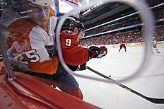Philadelphia Flyers center Ryan White (25) is checked into the boards by Washington Capitals defenseman Dmitry Orlov (9), from Russia, during the first period of Game 5 in the first round of the NHL Stanley Cup hockey playoffs, Friday, April 22, 2016, in Washington. (AP Photo/Alex Brandon)