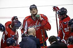 Washington Capitals left wing Alex Ovechkin (8), from Russia, squirts water down his sweater during a timeout in the third period of Game 5 in the first round of the NHL Stanley Cup hockey playoffs against the Philadelphia Flyers, Friday, April 22, 2016, in Washington. The Flyers won 2-0. (AP Photo/Alex Brandon)