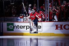 Washington Capitals goalie Braden Holtby (70) followed by left wing Alex Ovechkin (8), from Russia, take the ice for the start of Game 5 in the first round of the NHL Stanley Cup hockey playoffs against the Philadelphia Flyers, Friday, April 22, 2016, in Washington. (AP Photo/Alex Brandon)