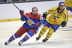 Ice Hockey — Sweden v Russia — Euro Hockey Tour — ABB Arena, Vasteras, Sweden — 23/4/16. Russia's Vyacheslav Voinov and Sweden's Mattias Tedenby in action. Fredrik Sandberg/TT News Agency/via REUTERS ATTENTION EDITORS — THIS IMAGE WAS PROVIDED BY A THIRD PARTY. FOR EDITORIAL USE ONLY. SWEDEN OUT. NO COMMERCIAL OR EDITORIAL SALES IN SWEDEN. NO COMMERCIAL SALES.