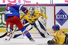 Russia's Vadim Shipachev, left, scores to take the score to 0-2, behind Sweden's goalie Jacob Markstrom during the Euro Hockey Tour ice hockey match Sweden vs Russia at the ABB Arena in Vasteras, Sweden, Saturday April 23, 2016. (Fredrik Sandberg / TT via AP) SWEDEN OUT
