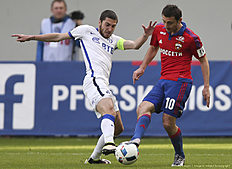 KHIMKI, RUSSIA � APRIL 24: Alan Dzagoev (R) of PFC CSKA Moscow challenged by Aleksei Ionov of FC Dinamo Moscow during the Russian Premier League match between PFC CSKA Moscow and FC Dinamo Moscow at Arena Khimki Stadium on April 24, 2016 in Khimki, Russia.