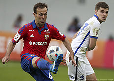 KHIMKI, RUSSIA — APRIL 24: Bibras Natkho (L) of PFC CSKA Moscow challenged by .Roman Zobnin of FC Dinamo Moscow during the Russian Premier League match between PFC CSKA Moscow and FC Dinamo Moscow at Arena Khimki Stadium on April 24, 2016 in Khimki, Russia.