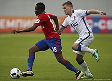 KHIMKI, RUSSIA — APRIL 24: Ahmed Musa (L) of PFC CSKA Moscow challenged by Igor Denisov of FC Dinamo Moscow during the Russian Premier League match between PFC CSKA Moscow and FC Dinamo Moscow at Arena Khimki Stadium on April 24, 2016 in Khimki, Russia.
