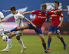KHIMKI, RUSSIA � APRIL 24: Pontus Wernbloom (R) of PFC CSKA Moscow challenged by Roman Zobnin of FC Dinamo Moscow during the Russian Premier League match between PFC CSKA Moscow and FC Dinamo Moscow at Arena Khimki Stadium on April 24, 2016 in Khimki, Russia.