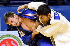France's Kilian Le Blouch (L) competes with Azerbaijan's Vugar Shirinli during the men's team bronze medal match at the men's team competition at the European Judo Championships in Kazan on April 24, 2016. / AFP / Vasily Maximov