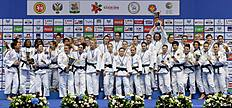 (L to R) France's (bronze), Poland's (gold), Russia's (silver) and Germany's (bronze) women judo teams pose on podium with their medals after competing in the European Judo Championships in Kazan on April 24, 2016. / AFP / Vasily Maximov