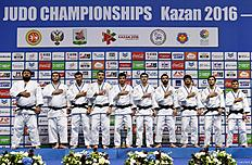 Georgia's men judo team poses on podium with their gold medals after competing in the European Judo Championships in Kazan on April 24, 2016. / AFP / Vasily Maximov