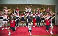 Russia's former and current Olympic team members, athletes and children present the Russian Olympic team's uniform for Rio de Janeiro 2016 Olympics in the Tretyakov picture gallery in Moscow, Russia, Monday, April 25, 2016. Background, from third left: former gymnast Olympic champpion Alexei Nemov, former Olympic gymnastics champion Svetlana Khorkina, Russian national volley-ball team coach Vladimir Alekhno, former figure skater Olympic champion Tatiana Navka, former ice hockey star Pavel Bure. (AP Photo/Pavel Golovkin)