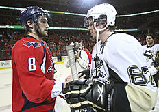FILE — In this March 13, 2009 file photo, Washington Capitals«Alex Ovechkin (8), from Russia, shakes hands with Pittsburgh Penguins»Sidney Crosby (87) following Game 7 of an NHL hockey second-round playoff series, in Washington. After dispatching the New York Rangers in five games, Pittsburgh faces top-seed Washington in the second round, their ninth postseason clash but the first since 2009. (AP Photo/Bruce Bennett, Pool, File)