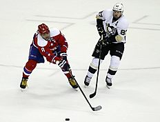 FILE � In this April 7, 2016 file photo, Washington Capitals left wing Alex Ovechkin (8), from Russia, loses the puck as Pittsburgh Penguins center Sidney Crosby (87) pursues in the third period of an NHL hockey game, in Washington. Sidney Crosby vs. Alex Ovechkin, Alex Ovechkin vs. Sidney Crosby. But the second-round playoff series between the Penguins and Capitals goes beyond the two NHL superstars. (AP Photo/Alex Brandon, File)