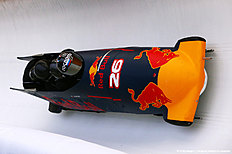 SOCHI, RUSSIA — APRIL 27: Members of the Russian national bobsleigh team ride in a Red Bull Racing bobsleigh during previews to the Formula One Grand Prix of Russia at Sanki Sliding Centre on April 27, 2016 in Sochi, Russia.