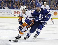 Tampa Bay Lightning center Tyler Johnson (9), defends New York Islanders' Nikolay Kulemin (86), of Russia, during the third period of Game 1 of the NHL hockey Stanley Cup Eastern Conference semifinals Wednesday, April 27, 2016, in Tampa, Fla. The Islanders won 5-3. (AP Photo/Chris O'Meara)