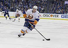 New York Islanders' Nikolay Kulemin (86), of Russia, controls the puck during Game 1 of the NHL hockey Stanley Cup Eastern Conference semifinals against the Tampa Bay Lightning, Wednesday, April 27, 2016, in Tampa, Fla. (AP Photo/Chris O'Meara)
