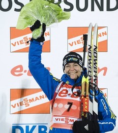 Sweden's Anna Carin Zidek (C) celebrates on the podium after winning the women's Biathlon 15km individual race in Oestersund on December 1, 2010.