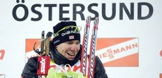 Norway's Emil Hegle Svendsen celebrates on the podium after winning the men's Biathlon 20km individual race on December 2, 2010 in Oestersund, Sweden.