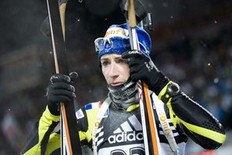 France's Marie Laure Brunet reacts after finishing 19th in the women's World Cup Biathlon 7.5 km sprint race in Oestersund on December 3, 2010.