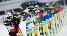 Juliane Doll of Germany (L) aims on the range on her way to the 27th place during the women's Biathlon 10 km pursuit race on December 5, 2010 in Oestersund, Sweden.