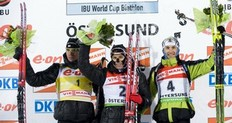 Ole Einar Bjoerndalen of Norway (C) celebrates on the podium with second-placed Emil Hegle (L) Svendsen of Norway and third-place Jakov Fak of Slovenia after the men's Biathlon 12.5 km pursuit race on December 5, 2010 in Oestersund, Sweden.