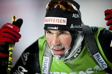 Benjamin Weger of Germany reacts after crossing the finish line at the 40th place during the men's Biathlon 10 km sprint race on December 4, 2010 in Oestersund, Sweden.