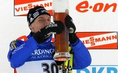 Bjorn Ferry of Sweden celebrates with glass of beer at podium after winning the men's 10 km sprint biathlon World Cup event in Pokljuka December 18, 2010.