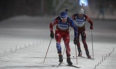 Michal Slesingr (L) of Czech Republic and Ole Einar Bjoerndalen of Norway compete to finish the 4x7.5 km men's relay competition at the Biathlon World Cup in the eastern German ski resort of Oberhof January 5, 2011. Germany won the competition, Czech Republic placed second and Norway placed third.