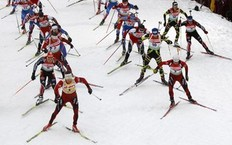 Norway's Tarjei Boe (L) leads the pack in the men's 15 km mass start competition at the Biathlon World Cup in the eastern German ski resort of Oberhof January 9, 2011. Norway's Tarjei Boe won the competition, his team mate Emil Hegle Svendsen placed second and Russia's Ivan Tcherezov placed third.