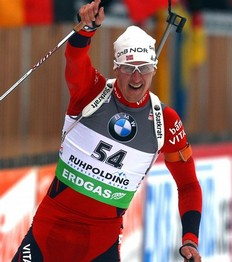 RUHPOLDING, GERMANY — JANUARY 14: Lars Berger of Norway wins the men's 10 km sprint event during the e.on IBU Biathlon World Cup at the Chiemgau Arena on January 14, 2011 in Ruhpolding, Germany.