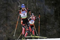 RUHPOLDING, GERMANY — JANUARY 15: Magdalena Neuner of Germany takes 3rd place, Andrea Henkel of Germany takes 2nd place during the IBU World Cup Biathlon Women's 7.5 km Sprint on January 15, 2011 in Ruhpolding, Germany.