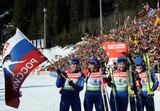 Russian team (LtoR) Natalia Guseva, Olga Zaitseva, Anna bogaliy Titovets and Svetlana Sleptsova celebrate on the finish area of the Women's 4x6 km relay event of the Biathlon World Cup in Anterselva on January 22, 2011. Russia won ahead of Sweden and Germany.