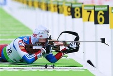Ivan Tcherezov, of Russia, shoots on his way to a third place finish in the men's 10 kilometer sprint at the Biathlon World Cup, Friday, Feb. 4, 2011, in Presque Isle, Maine.