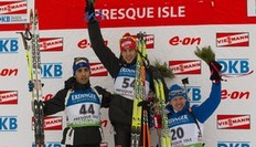 Germany's Arnd Peiffer (C) and France's Martin Fourcade (L) and Russia's Ivan Tcherezov celebrate their first, second and third place finishes during the IBU World Cup Biathlon Men's 10km Sprint February 4, 2011 in Presque, Isle, Maine.