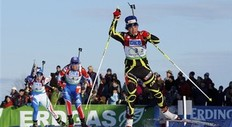 France's Sophie Boilley, right, leads, Russia's Natalia Guzeva, center, and Italy's Katja Haller, during the mixed relay race at the Biathlon World Cup, Saturday, Feb. 5, 2011, in Presque Isle, Maine.