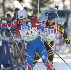 Russia's Ivan Tcherezov (L) is chased by France's Jay Vincent during the IBU World Cup Biathlon Mixed Relay February 5, 2011 in Presque Isle, Maine. Germany finished first with France in second and Russia in third.