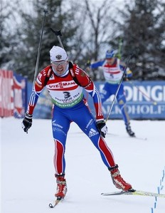 Russia's Ivan Tcherezov beats out Sweden's Carl Johan Bergman to place second in the men's pursuit at the Biathlon World Cup, Sunday, Feb. 6, 2011, in Presque Isle, Maine.