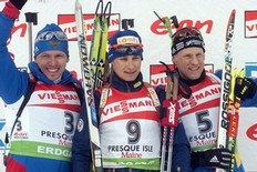 Russia's Ivan Tcherezov (L), second, France's Alexis Boeuf (C), first, and Sweden's Carl Johan Bergman, third, celebrate after the IBU World Cup Biathlon Men's 12.5 km Pursuit on February 6, 2011 in Presque Isle, Maine.