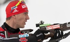 Germany's Arnd Peiffer shoots during the IBU World Cup Biathlon Men's 12.5 km Pursuit on February 6, 2011 in Presque Isle, Maine.