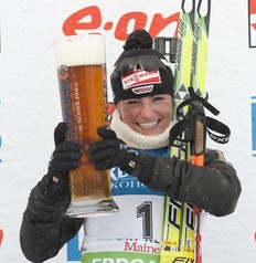Germany's Andrea Henkel toasts with a beer after the IBU World Cup Biathlon Women's 10 KM Pursuit February 12, 2011 in Fort Kent, Maine. Henkel won the race.