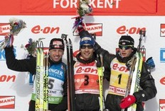 Poland's Tomasz Sikora (L), second, France's Martin Fourcade (C), first, and Norway's Tarjei Boe, third, celebrate after the IBU World Cup Biathlon Men's 15 KM Mass Start February 13, 2011 in Fort Kent, Maine.