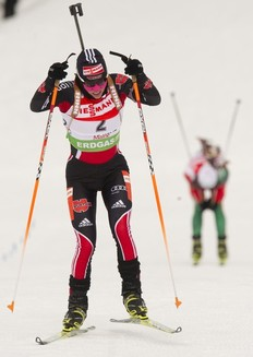 Germany's Andrea Henkel (L) finishes ahead of Darya Domracheva of Belarus during the IBU World Cup Biathlon Women's 12.5 KM Mass Start February 13, 2011 in Fort Kent, Maine. Henkel finished second in the event.