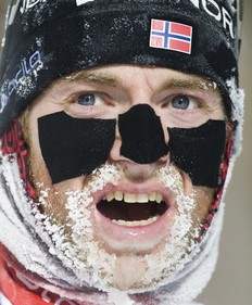 Alexander Os of Norway reacts after crossing the finish line on the 26th place of the men's Biathlon 20km individual race on December 2, 2010 in Oestersund, Sweden.