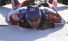 Andrei Makoveev of Russia recovers after crossing the finish line of the men's 10 km individual sprint race at the IBU Biathlon World Championships in Khanty-Mansiysk, Western Siberia, Russia, March 5 2011.