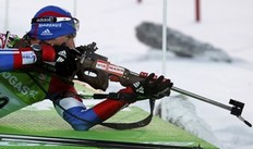 Maxim Maksimov of Russia prepares to shoot during the men's 20 km individual race at the IBU Biathlon World Championships in Khanty-Mansiysk, March 8, 2011.