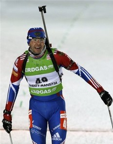 Second placed Maxim Maksimov of Russia crosses the finish line of the men's 20 km individual at the IBU World Championships Biathlon at Khanty-Mansiysk, 2759 km North-East of Moscow, Russia, Tuesday, March 8, 2011.