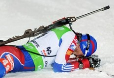 Maxim Maksimov of Russia reacts after crossing the finish line to take second place in the men's individual 20 km Biathlon World Championship race in the Siberian city of Khanty-Mansiysk on March 8, 2011.