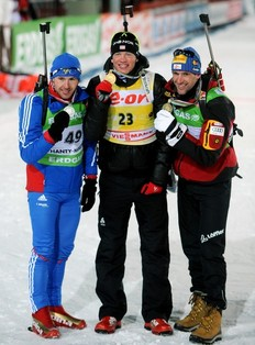 Tarjei Boe (C) of Norway poses with his gold medal between second place winner Maxim Maksimov (L) of Russia and third place winner Christoph Sumann (R) of Austria on March 8, 2011 after the men's individual 20 km Biathlon World Championship race in the Siberian city of Khanty-Mansiysk.