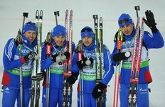 From left: Ivan Tcherezov, Maxim Maksimov, Evgeny Ustyugov and Anton Shipulin of Russia pose with silver medals after placing second in the Men's 4 x 7,5 km relay event of the Biathlon World Championships in the Siberian city of Khanty-Mansiysk on March 11, 2011.